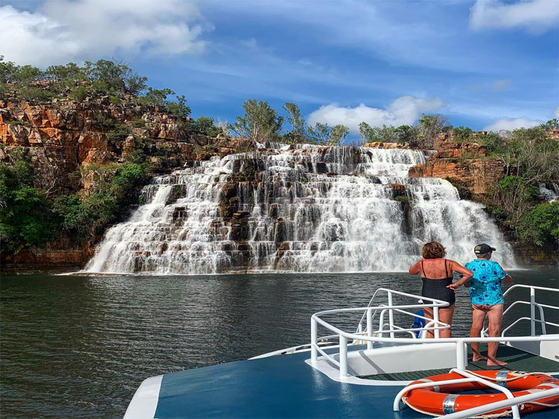 LADY M Kimberley cruises people on bow Kings Cascades