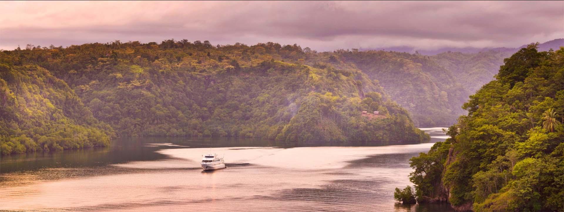 TRUE NORTH Adventures in Paradise cruise vessel at dawn
