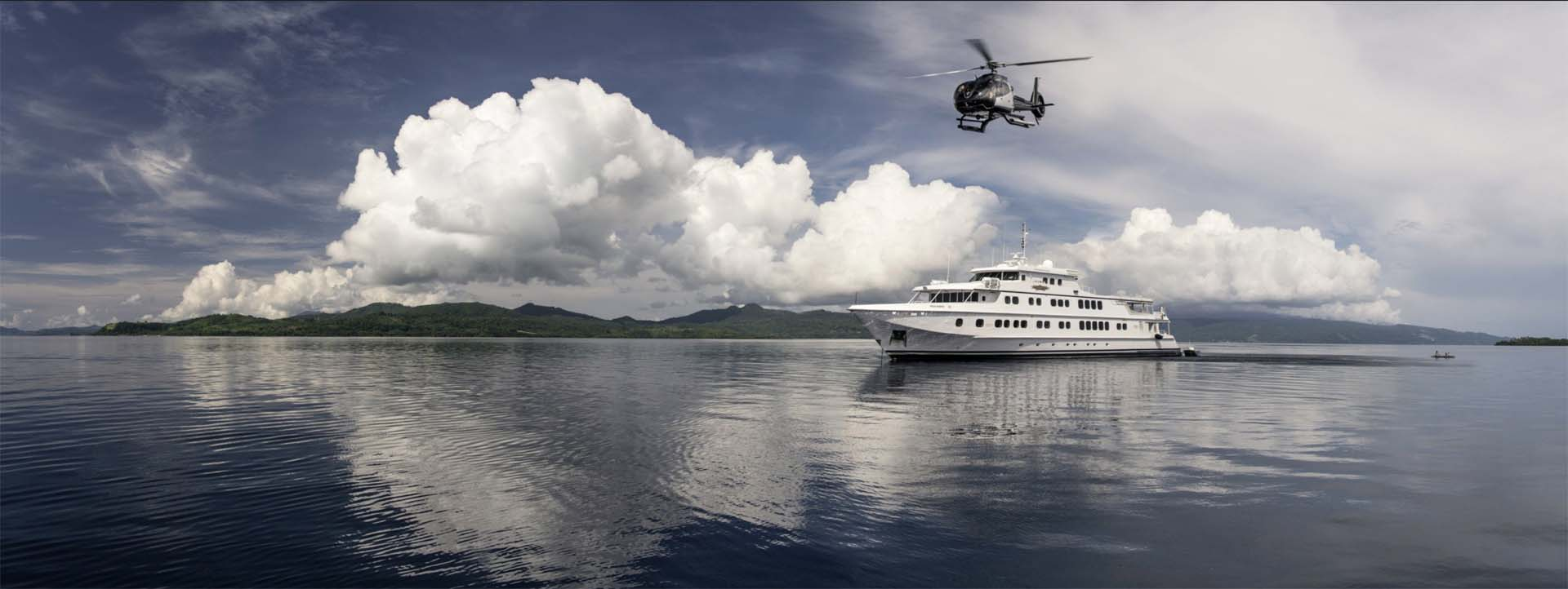 TRUE NORTH Kimberley cruise helicopter and vessel grey skies