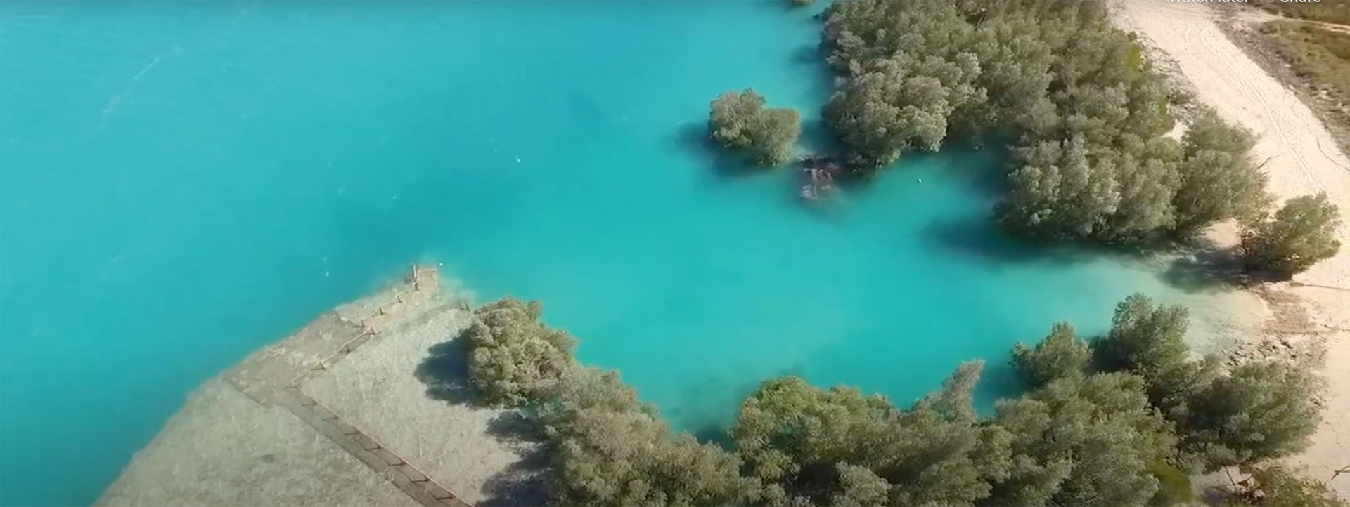 WILLIE CREEK PEARL FARM TOURS aerial turquoise waters image